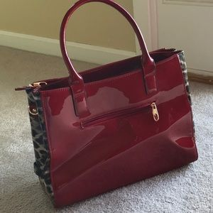 Red pattern leather hand bag